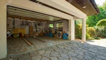 42198965-Carton-boxes-and-bikes-in-the-garage-Stock-Photo-garage-home-house
